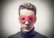Young man with a red mask stock images