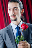 Young man with red rose Royalty Free Stock Images