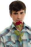 Young man with red rose Stock Photos