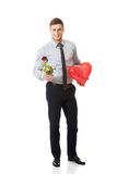 Young man with a red rose and heart balloon. Stock Images