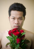 Young man and red rose Royalty Free Stock Photography