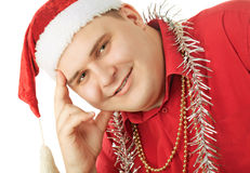 Young man in a red shirt, hat Santa Claus and tins Royalty Free Stock Photos
