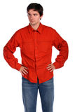 Young man in red shirt posing Stock Images