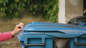 Young man in red sportswear throwing away rubbish stock footage