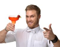 Young man with red strawberry margarita cocktail drink juice happy pointing one finger royalty free stock photo