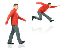 Young man in red sweater goes and jumps Stock Photo