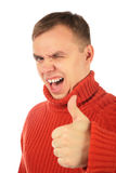 Young man in red sweater makes gesture by finger stock images
