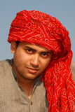 Young man with red turban Royalty Free Stock Images