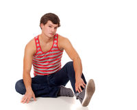 Young man in red and white striped shirt and jeans Stock Photo