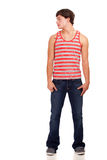 Young man in red and white striped shirt and jeans Royalty Free Stock Image