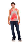 Young man in red and white striped shirt and jeans Royalty Free Stock Images