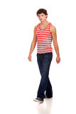Young man in red and white striped shirt and jeans Stock Photography