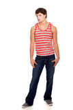 Young man in red and white striped shirt and jeans Stock Photos