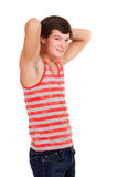Young man in red and white striped shirt and jeans Royalty Free Stock Photo