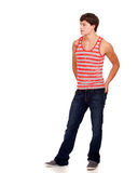 Young man in red and white striped shirt and jeans Royalty Free Stock Photography