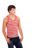 Young man in red and white striped shirt and jeans Royalty Free Stock Photos