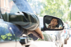 Young Man Reflection on Car Side Mirror Royalty Free Stock Photos