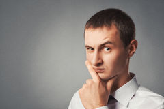 Young man reflects concentrated Royalty Free Stock Photo