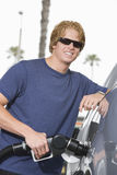 Young Man Refueling His Car Stock Photography