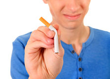 Young Man refuse a Cigarette. Young Man Destroy a Cigarette on the White Background. Focus on the Hand Royalty Free Stock Images