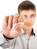 Young Man refuse a Cigarette. Young Man Destroy a Cigarette on the White Background. Focus on the Hand Stock Image