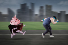 Young man refuse to eat cupcake Stock Image