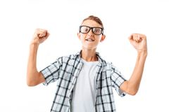 A young man rejoices at the victory, in the Studio on a white background, copy space to the left of guy royalty free stock photography