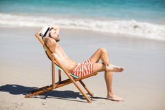 Young man relaxing on armchair Royalty Free Stock Photography