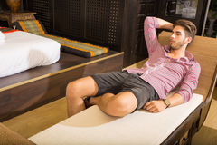 Young man relaxing in an Asian-styled hotel room Stock Image