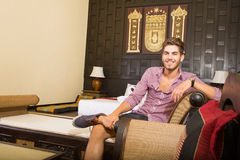 Young man relaxing in an Asian-styled hotel room Stock Images