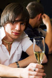 Young man relaxing in a bar. Royalty Free Stock Images