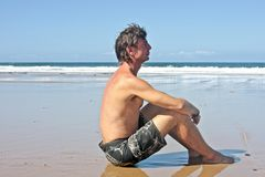 Young man relaxing on the beach Royalty Free Stock Photo
