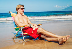 Young Man Relaxing at the Beach Royalty Free Stock Images
