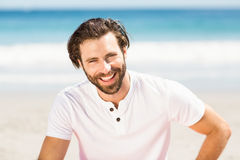 Young man relaxing on beach Royalty Free Stock Photos
