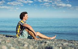 Young Man Relaxing on Beach Stock Photography
