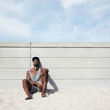 Young man relaxing on the beach Stock Photography