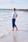 Young man is relaxing on beach in summer vacation Royalty Free Stock Images