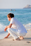 Young man is relaxing on beach in summer vacation Stock Images