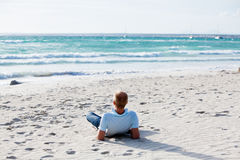 Young man is relaxing on beach in summer vacation Stock Photography