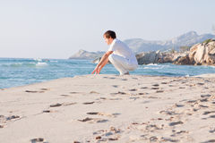 Young man is relaxing on beach in summer vacation Stock Image