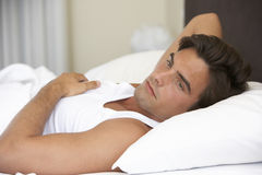 Young Man Relaxing On Bed Royalty Free Stock Photography