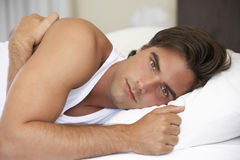 Young Man Relaxing On Bed Royalty Free Stock Photo