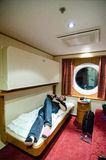 Young man relaxing in boat cabin Royalty Free Stock Photo