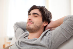 Young man relaxing during a break in sofa Stock Photography