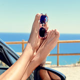 Young man relaxing in a car near the ocean Royalty Free Stock Photography