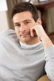 Young Man Relaxing In Chair At Home Royalty Free Stock Photos