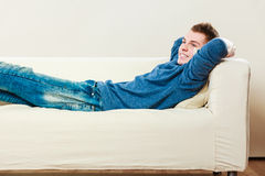 Young man relaxing on couch Royalty Free Stock Photography