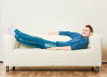 Young man relaxing on couch Royalty Free Stock Photos
