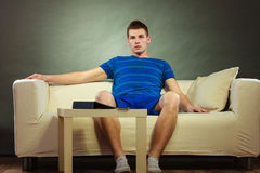 Young man relaxing on couch Stock Images