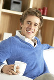 Young Man Relaxing With Cup Of Coffee Stock Photos